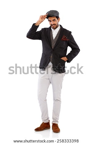 Studio shot of attractive young indian man in stylish retro outfit posing on white background - stock photo