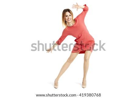 Studio shot of beautiful woman moves like goalkeeper. - stock photo
