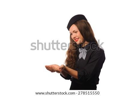 Studio shot of beautiful young flight attendant in black clothing - stock photo