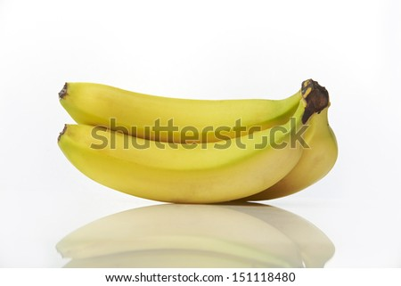 Studio shot of bunch of bananas on white background with reflection - stock photo