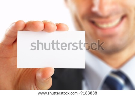 Studio shot of Businessman presenting his business card - selective focus