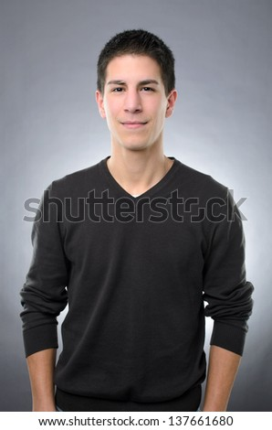 Studio shot of casual smiling man on gray background