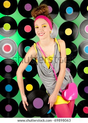 studio shot of cheerful teenage girl over the colorful background - stock photo