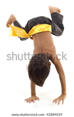 Studio Shot of Child in Martial Arts. - stock photo