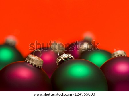 Studio shot of christmas baubles on colored background