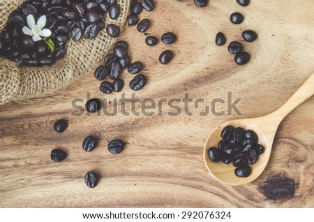 Studio Shot of Coffee Beans in a Bag with wooden table: vintage process - stock photo