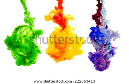 Studio shot of colored ink in water, isolated on white background