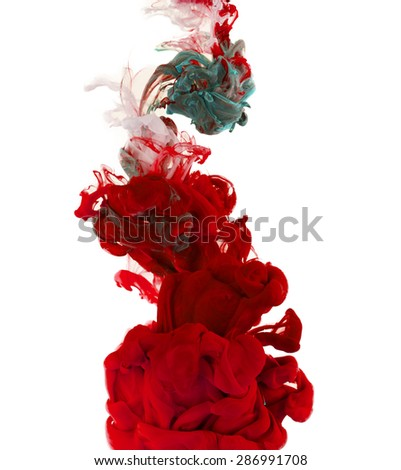 Studio shot of colored ink in water, isolated on white background - stock photo