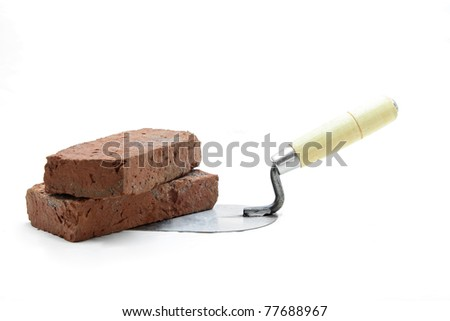 Studio shot of construction lute trowel with red brick isolated on white - stock photo