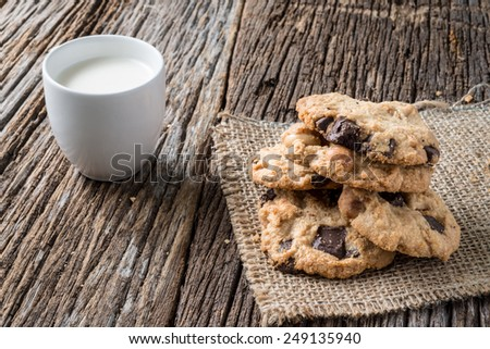 Studio Shot of Cookies and milk on wooden background - stock photo