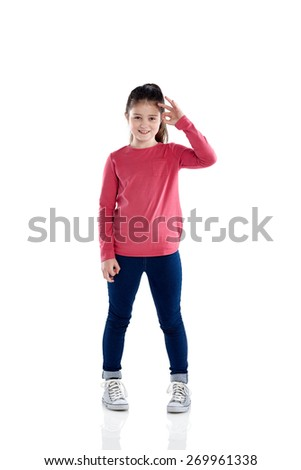 Studio shot of cute little girl showing ok sign with her hand on white background - stock photo