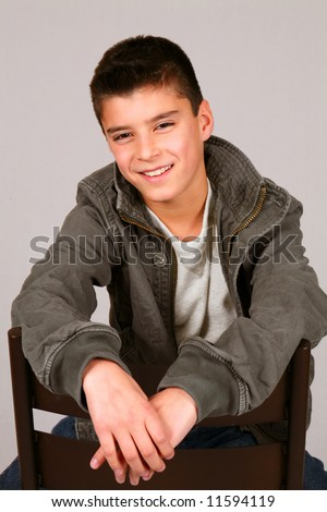 studio shot of cute preteen boy in casual clothes - stock photo