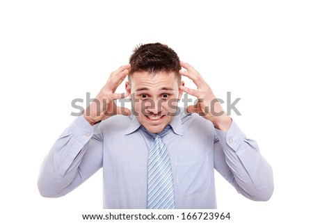 Studio shot of desperate businessman with hands on head, isolated over white background - stock photo