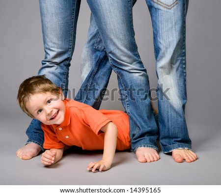 Studio shot of family of three wearing blue jeans