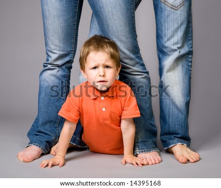 Studio shot of family of three wearing blue jeans - stock photo
