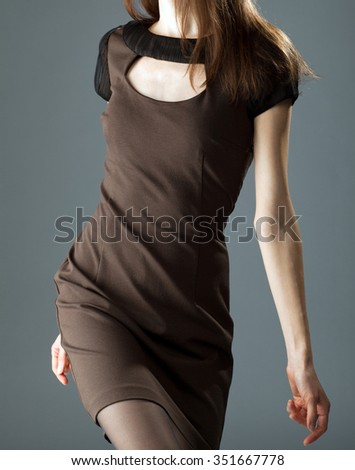 Studio shot of fashion model: attractive young brunette isolated over neutral background - stock photo