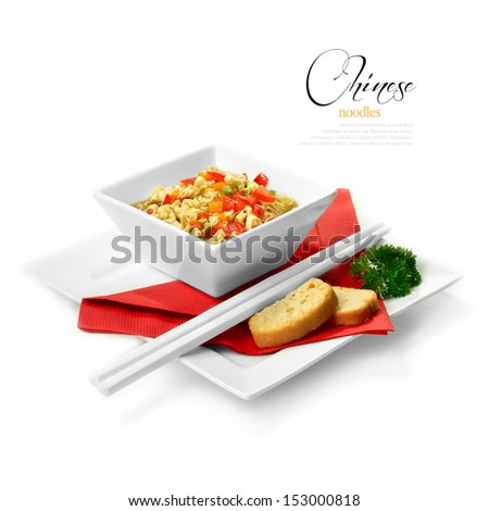 Studio shot of freshly prepared Chinese ribbon noodles with crisp breads. Selectively lit to create soft shadows against a white background. Copy space. - stock photo