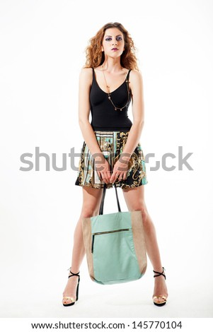 studio shot of girl with full shopping bag in white background