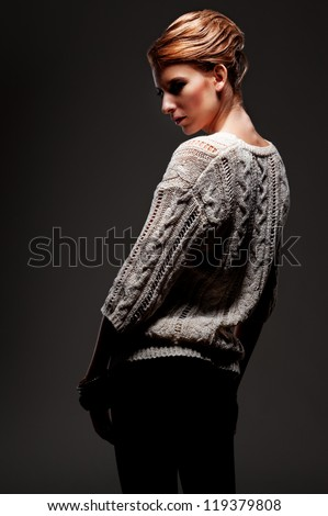 studio shot of glamor woman in darkness - stock photo