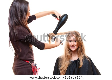 studio shot of hairdresser with hairdryer. isolated on white - stock photo