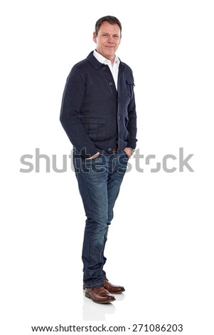 Studio shot of handsome mature man standing with his hands in pocket over white background