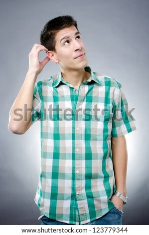 Studio shot of handsome thoughtful man in casual clothes - stock photo