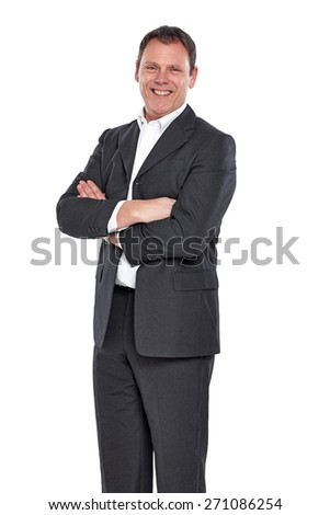 Studio shot of happy mature business executive standing with his arms crossed over white background - stock photo