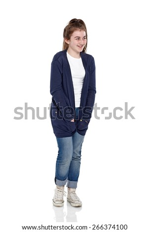 Studio shot of happy young girl looking away at copyspace smiling on white background - stock photo