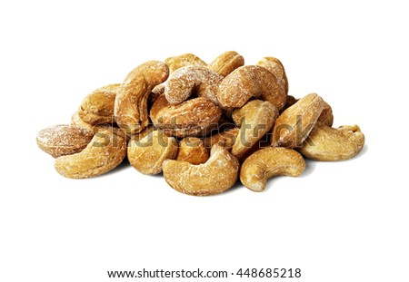 Studio shot of heap of cashew nuts isolated on white background.