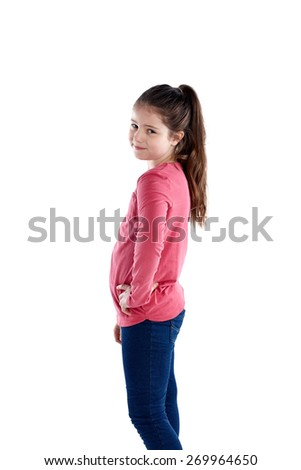 Studio shot of innocent little girl looking at camera while standing on white background - stock photo