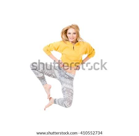 Studio shot of jumping woman in sport dress. - stock photo