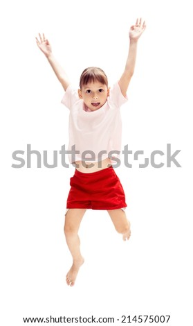 Studio shot of little girl jumping, isolated