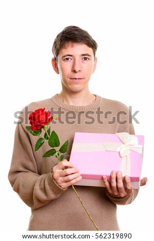 Studio shot of man holding red rose and gift box ready for Valentine's day ready for Valentine's Day