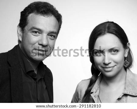 Studio shot of mature man and young woman - stock photo