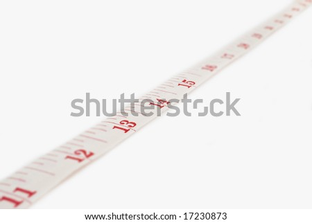 Studio shot of measuring tape against white background