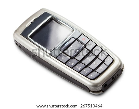 Studio shot of old cell phone isolated on white. - stock photo