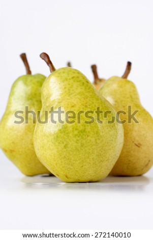 Studio shot of pears on white background - stock photo