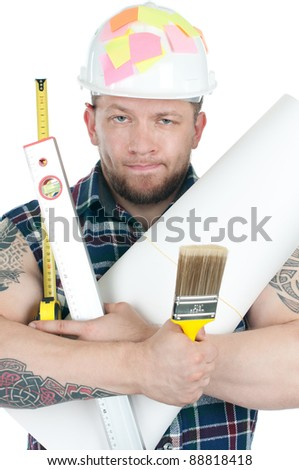 Studio shot of puzzled caucasian construction worker holding a heap of various working tools, over a white background - stock photo