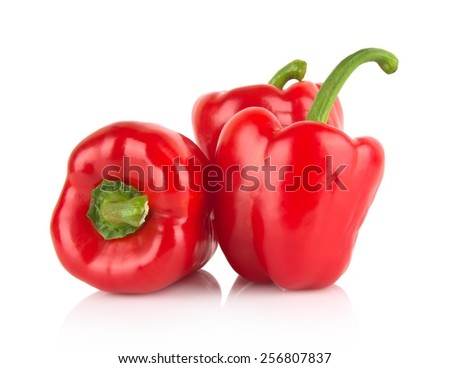 Studio shot of red bell peppers isolated on white background