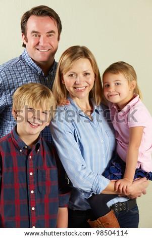 Studio Shot Of Relaxed Family - stock photo