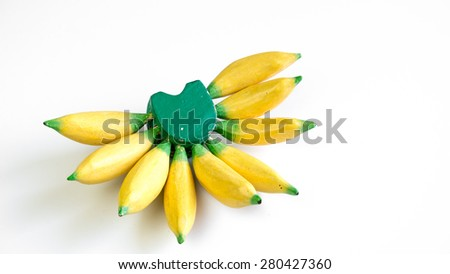 Studio shot of ripe bananas replica made from wood. Concept of tropical fruit. Copy space. - stock photo