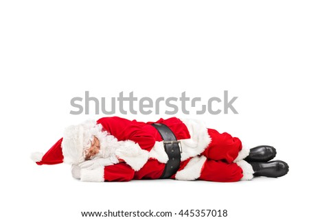 Studio shot of Santa Claus sleeping on the floor isolated on white background