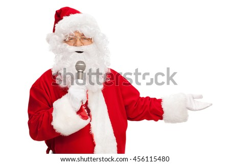 Studio shot of Santa Claus speaking on a microphone isolated on white background - stock photo