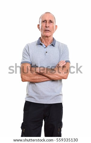 Studio shot of senior man standing with arms crossed isolated against white background