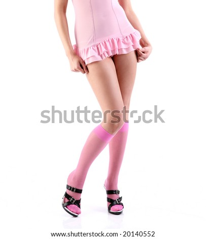 Studio shot of sexy legs in pink stockings and high heels. - stock photo
