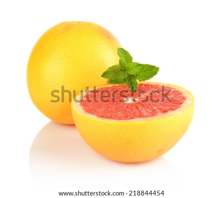 Studio shot of sliced grapefruits and mint isolated white background - stock photo