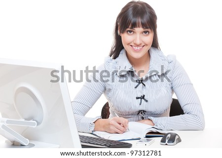 studio shot of smiley woman in office writing something in notebook. over white background - stock photo