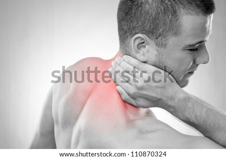 Studio shot of sportsman with pain in neck - stock photo