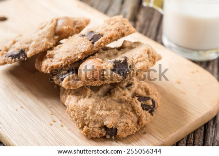 Studio Shot of Stack of Chocolate chip cookie and glass of milk