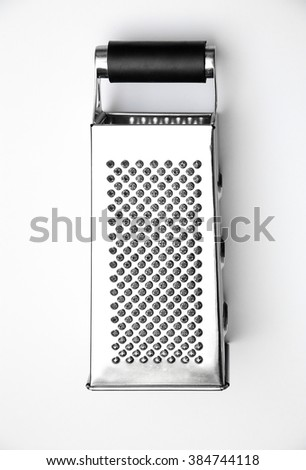 Studio shot of stainless steel grater on white background. Top view. Flat lay.